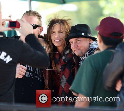Steven Tyler poses with fans after having lunch...