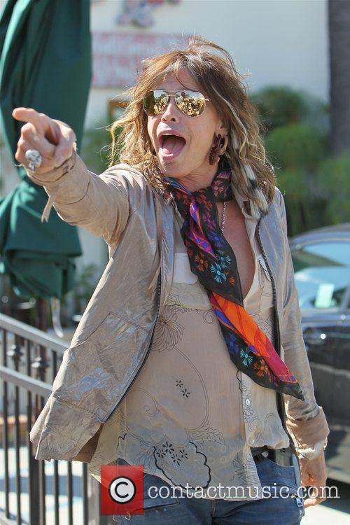 Steven Tyler laughing and pointing at a photographer...