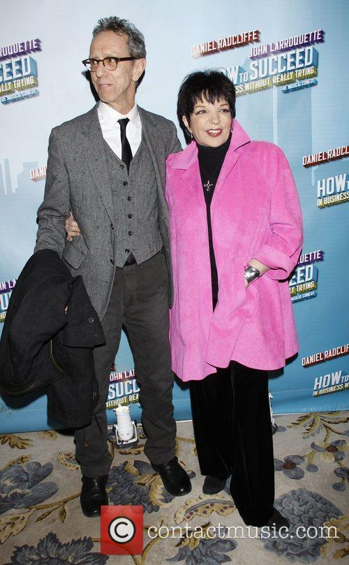 Guest and Liza Minnelli wearing Geoffrey Beene Opening...