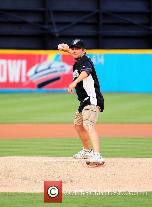 Christian Slater throw the first pitch during the...