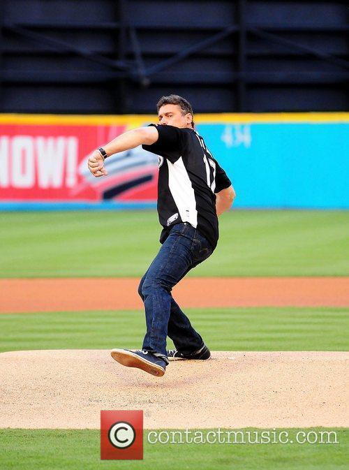 Steven Bauer throw the first pitch during the...