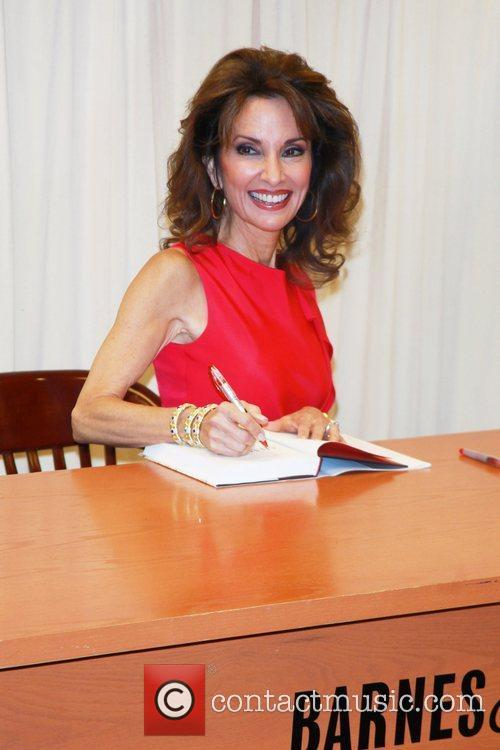 Signs copies of her book 'All My Life:...