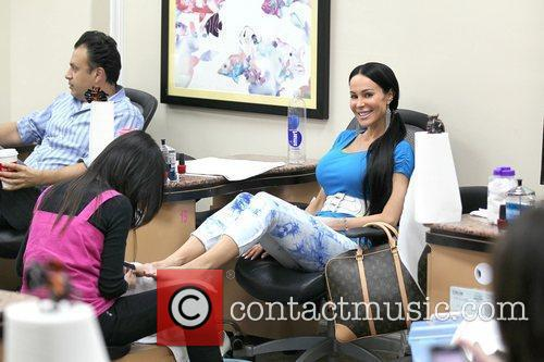 Tabitha Taylor gets a manicure and pedicure at...