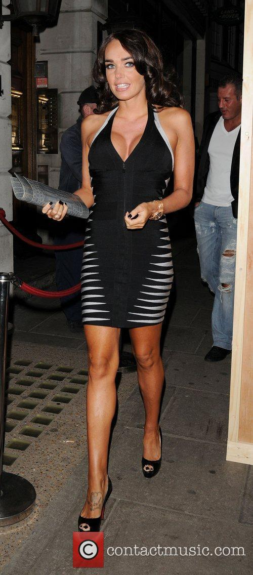 Tamara Ecclestone wearing a black and grey dress...