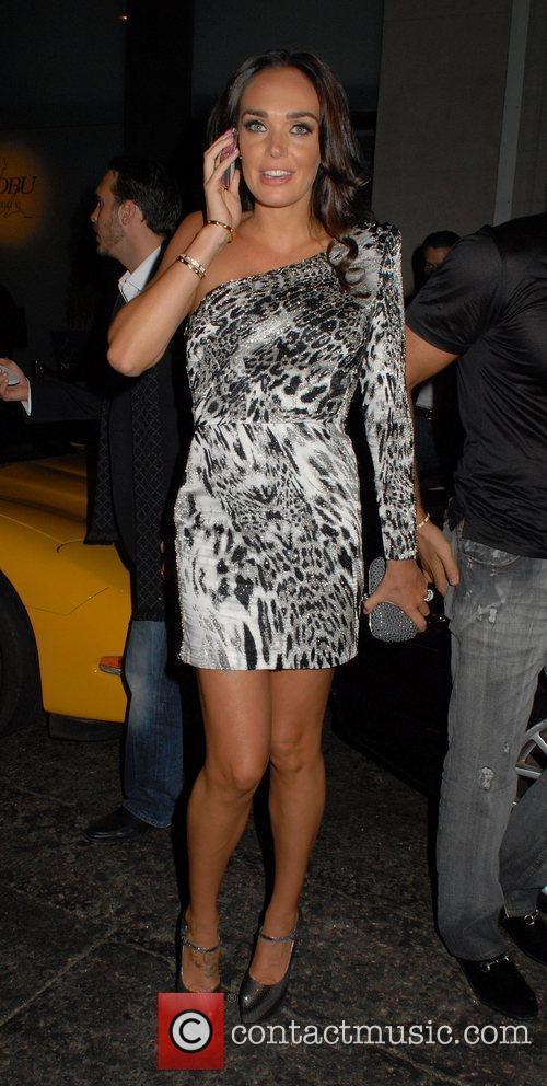Tamara Ecclestone wearing an animal print dress as...