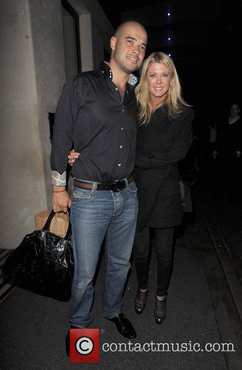 Tara Reid and her husband Zack Kehayov pose...
