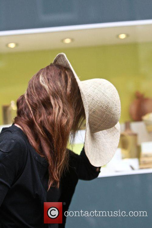 Tara Palmer Tomkinson hides her face from view...