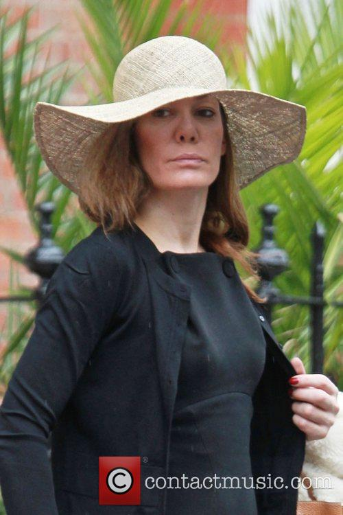 Tara Palmer Tomkinson gets caught in a downpour...