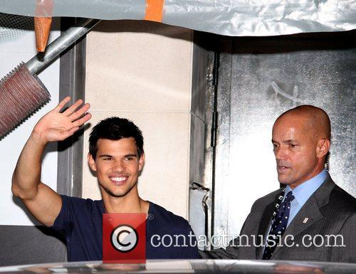 Taylor Lautner waving to fans outside of Fnac...