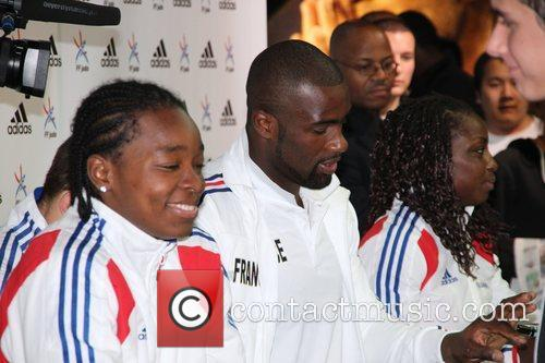 Teddy Riner and teammates sign autographs at the...
