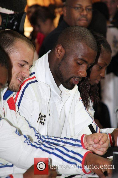 Sign autographs at the Adidas Store on the...