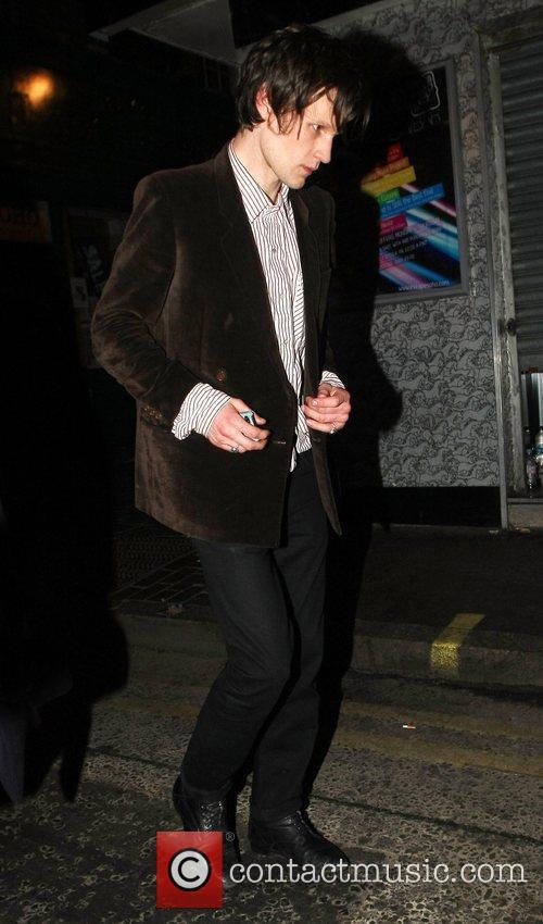 Matt Smith appears camera shy as he leaves...