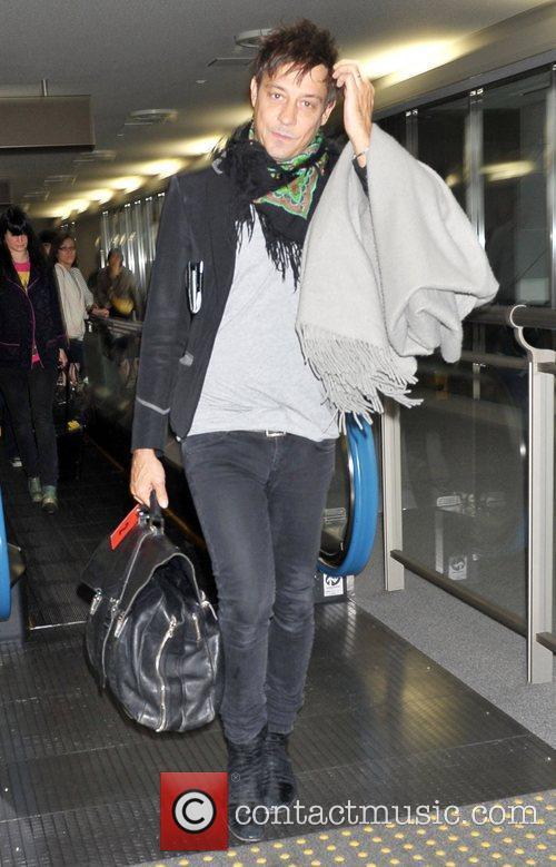 The Kills arrive at Narita International Airport to...