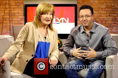 Marilyn Denis and John Edward  appearing on...
