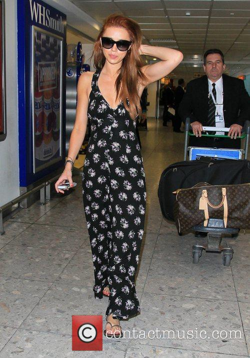 The Saturdays arrive at Heathrow airport after flying...