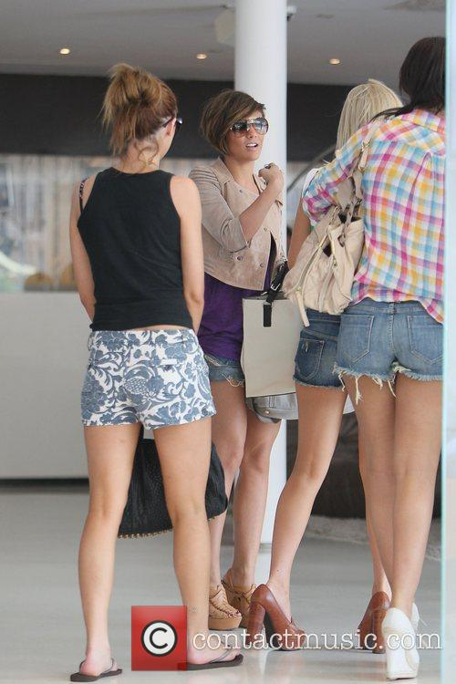 The Saturdays return to their hotel from a...