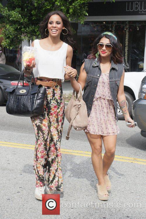 Vanessa White and Rochelle Wiseman eating from a...