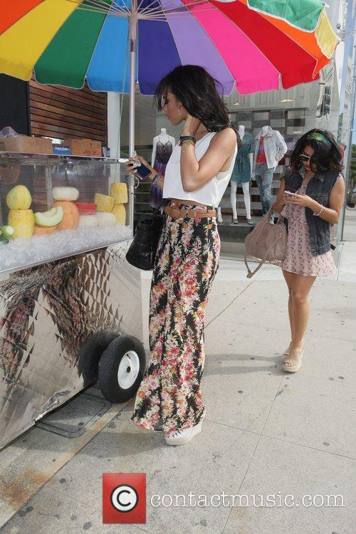 Vanessa White and Rochelle Wiseman purchasing a bag...