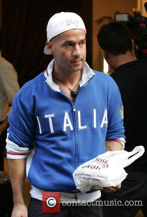 Wearing a backward white hat and an 'Italia'...