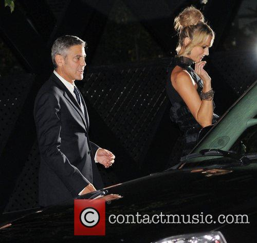 George Clooney and Stacy Keibler after attending the...