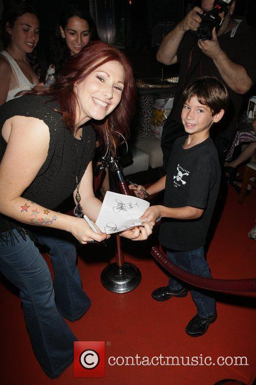 Tiffany aka Tiffany Darwish appears at Planet Hollywood...