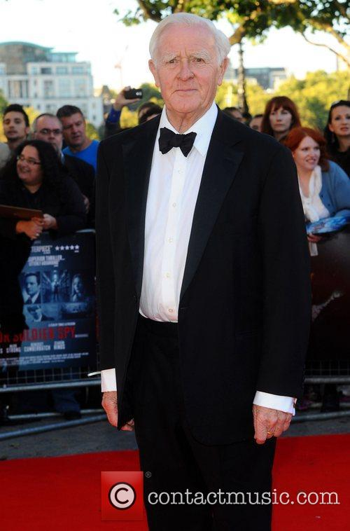 John Le Carre,  at the premiere of...