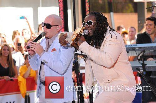 Pitbull and T.Pain  performing at the Toyota...