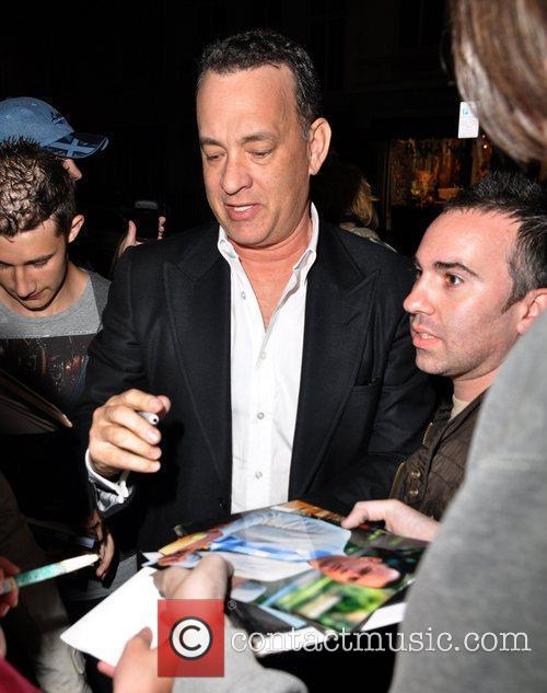 Tom Hanks signing autographs outside his hotel London,...