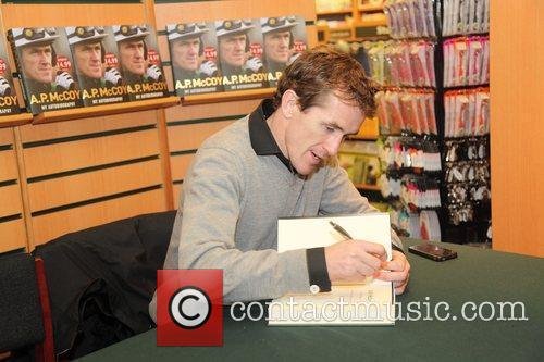 Signs copies of his book 'A.P. McCoy: An...