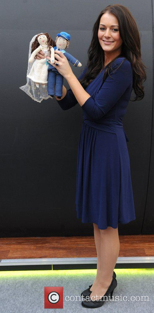 A Kate Middleton look-a-like poses with knit William...