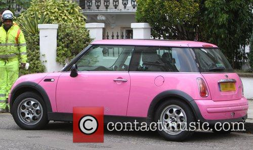 Returns to her pink Mini Cooper after dropping...