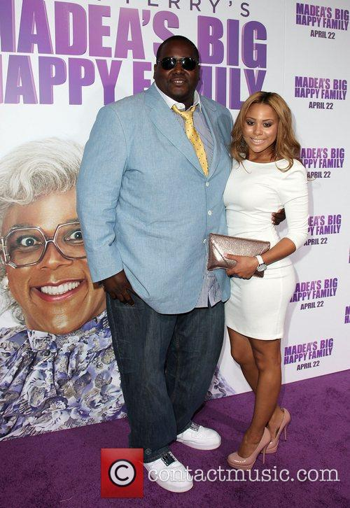 Quinton Aaron and guest Los Angeles Premiere of...