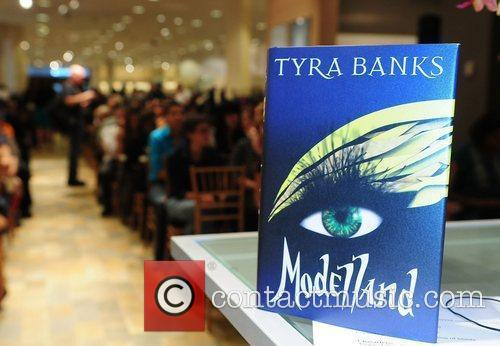 Tyra Banks greets fans and signs copies of...