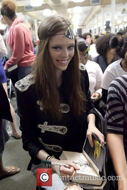 Coco Rocha in the audience Tyra Banks signs...
