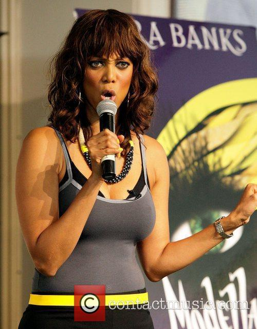 Tyra Banks  signs copies of her new...