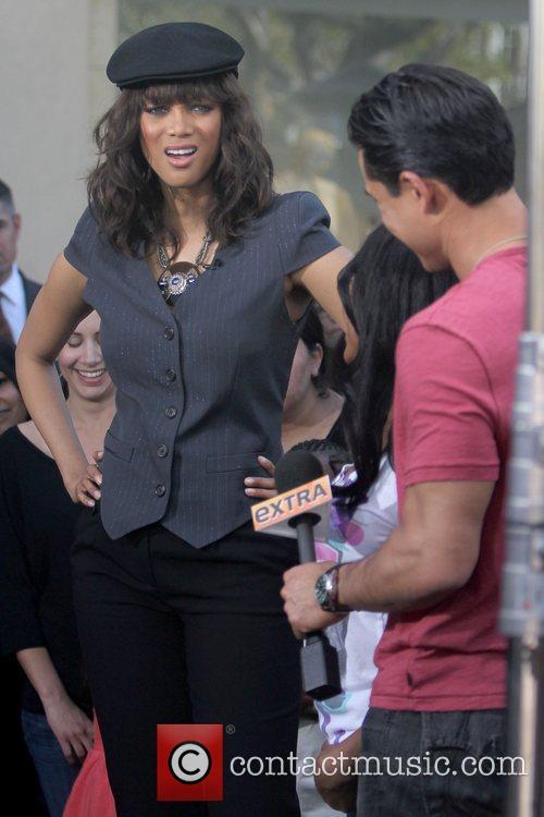 Tyra Banks and Mario Lopez Tyra Banks filming...