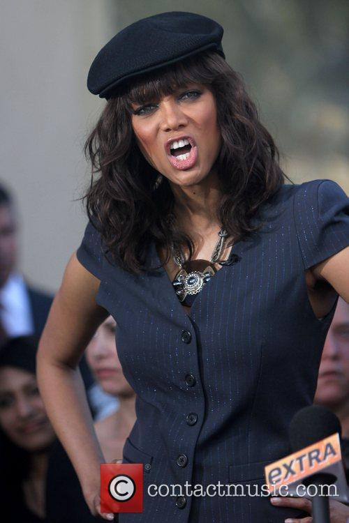Tyra Banks filming an interview for entertainment television...