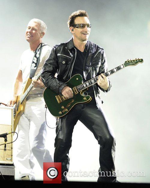 Paul Hewson, 'Bono', and Adam Clayton  performs...