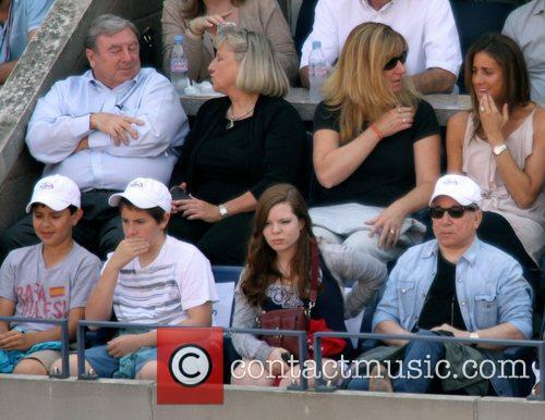 Paul Simon watches Novak Djokovic of Serbia play...