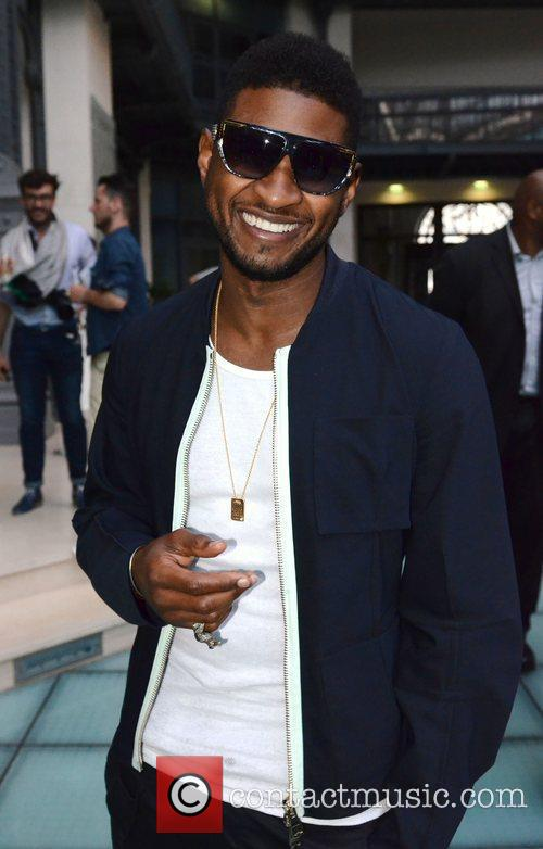 Usher attends the Raf Simons fashion show in...