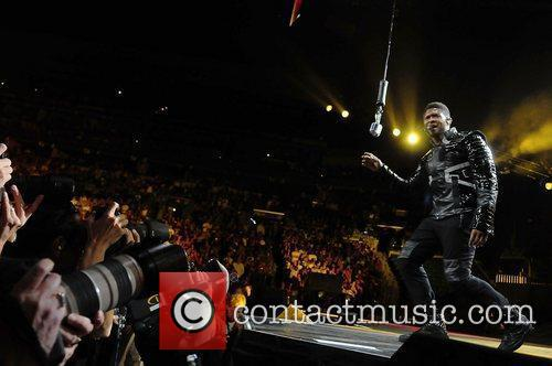R&B artist Usher, performing on his 'OMG Tour'...