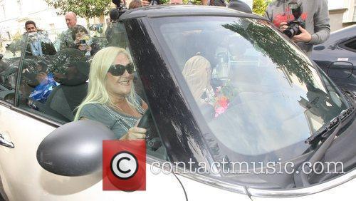 Vanessa Feltz driving her convertible Mini Cooper in...