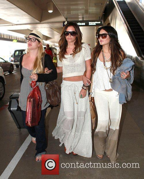 Ashley Tisdale (centre) and Vanessa Hudgens (right) arrive...