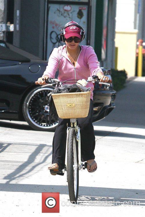 Vanessa Hudgens running errands on her bicycle in...