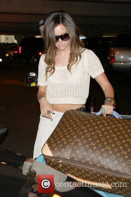 Ashley Tisdale arrives at LAX from a holiday...