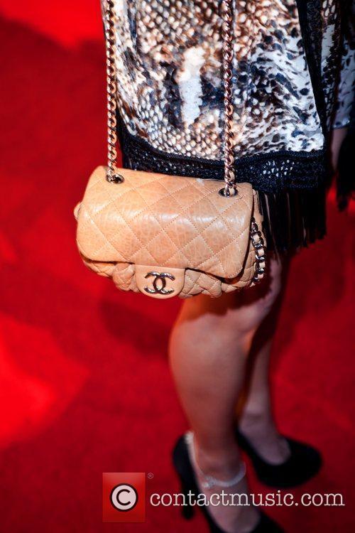 Vanessa Hudgens' Chanel purse Vanessa Hudgen celebrates the...