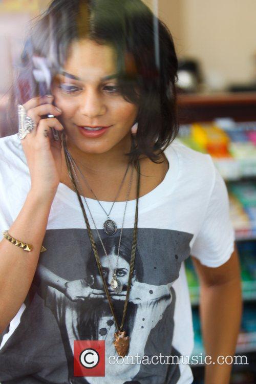 Vanessa Hudgens talking on her cell phone as...