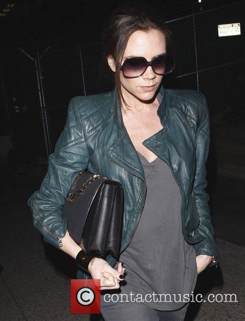 Pregnant Victoria Beckham arriving at LAX on a...