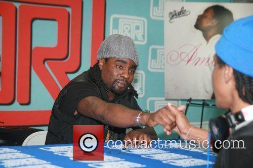 Wale signs copies of his album Ambition at...