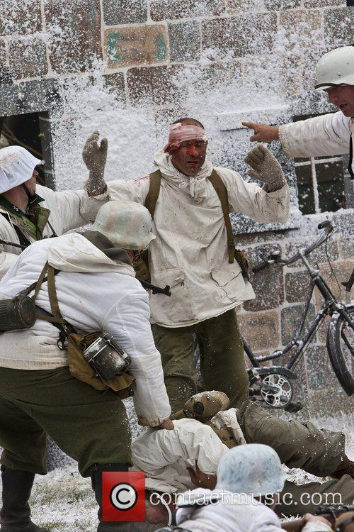 Men and women reenact scenes and battles from the Second